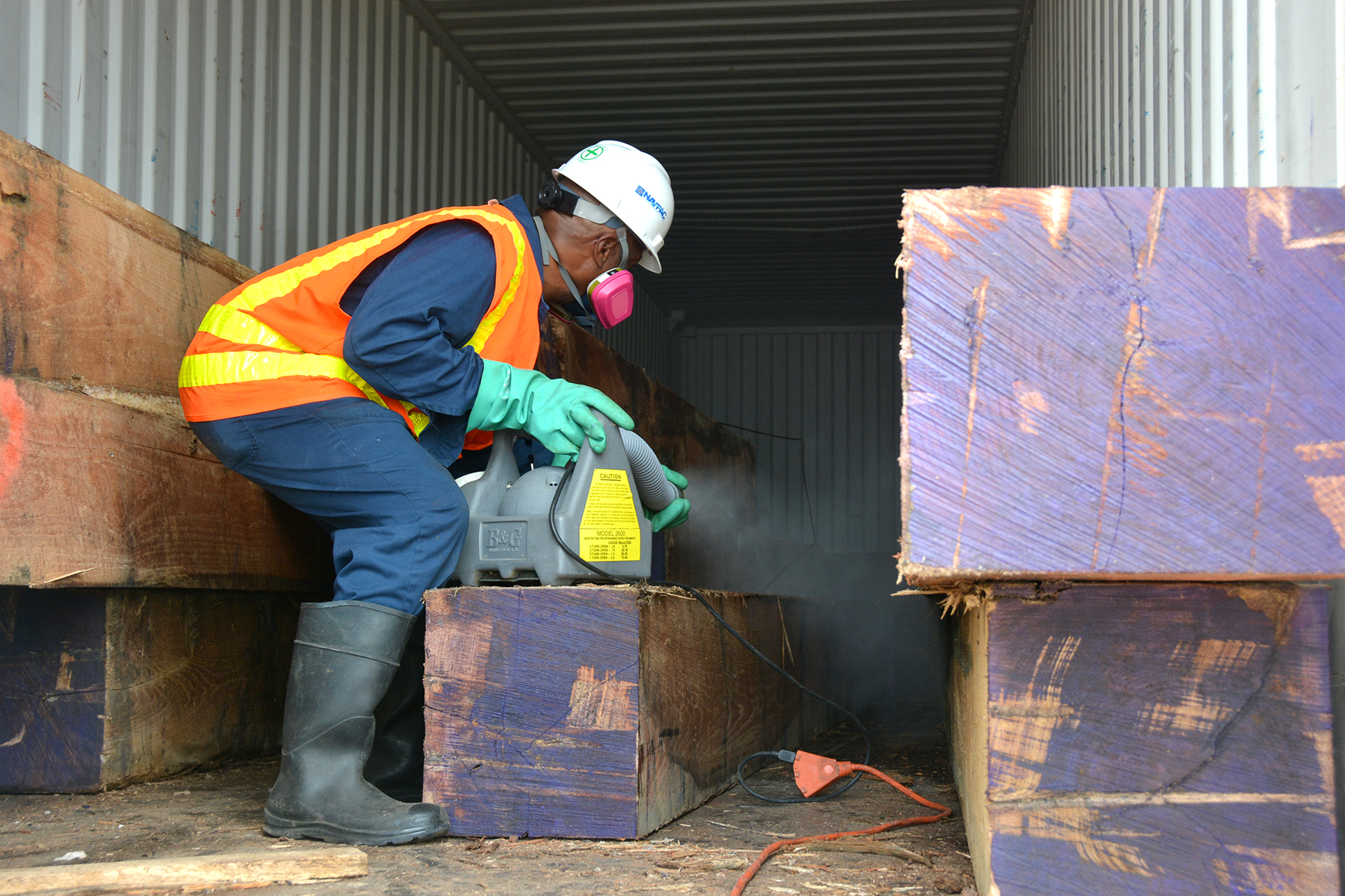 PEARL HARBOR-HICKAM, Hawaii (Feb. 24, 2015) Pest Control personnel from Naval Facilities Engineering Command Hawaii were called out to treat two shipping containers with large oak timbers from Tennessee due to an unidentified ant species that was discovered Feb. 24 at Joint Base Pearl Harbor-Hickam (JBPHH). The contents of each container was treated in the morning and then in the afternoon, killing the ant colonies found at both locations. State of Hawaii Department of Agriculture was on scene and collected some of the ants. They are working to properly identify them. (U.S. Navy photo by Denise Emsley, NAVFAC Hawaii Public Affairs/Released)